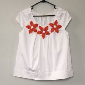 Crisp white cap sleeve top with flower appliqués
